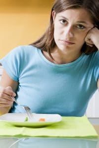 Sad woman in front of her small diet meal Hypnotherapy Dartford, Gravesend Kent Richard Wain Cressingham